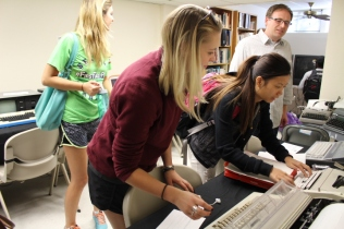 Professor Ted Striphas' undergraduate students making using of the MAL's typewriters